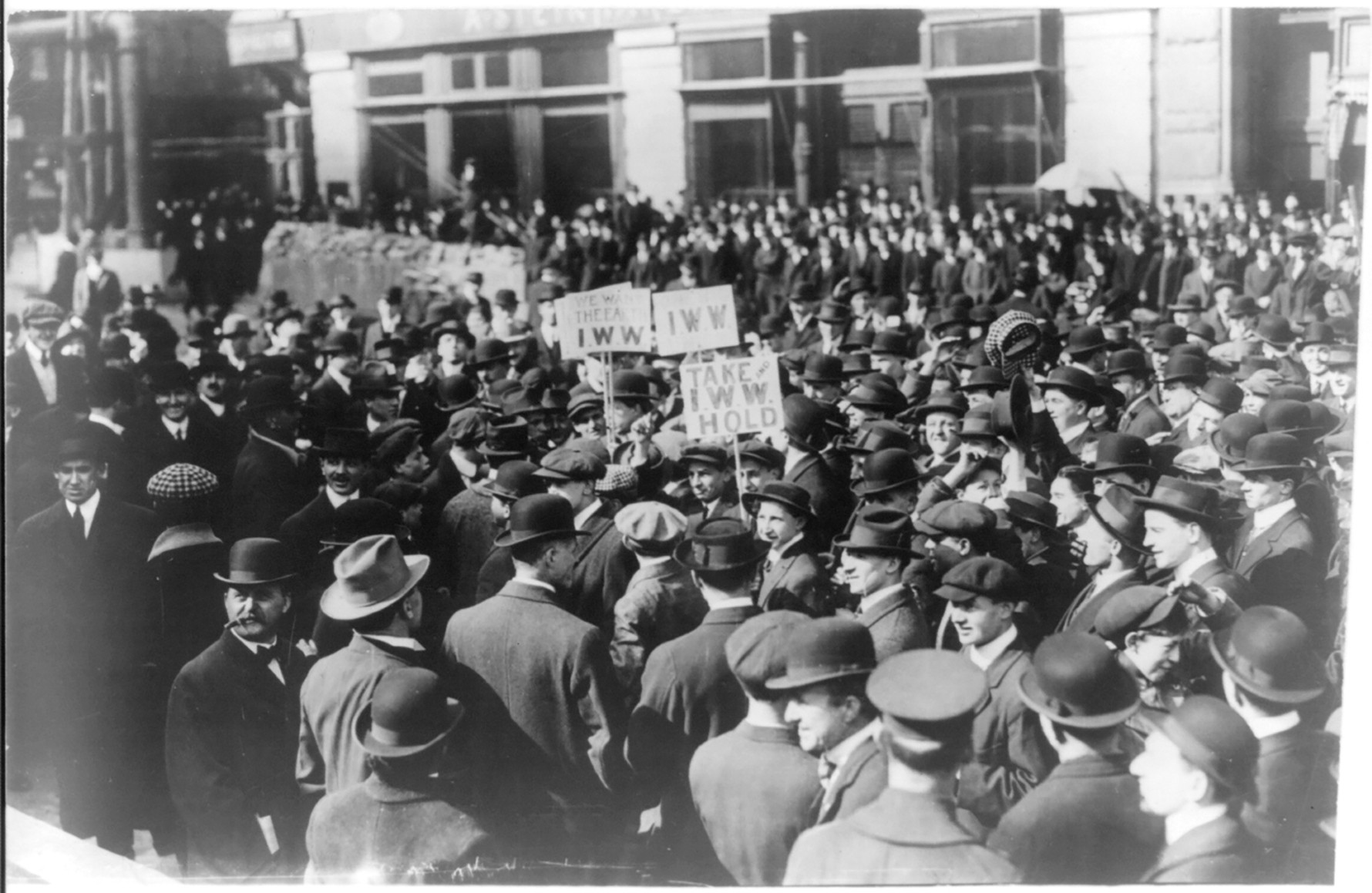 A black-and-white photo of an Industrial Workers of the World demonstration