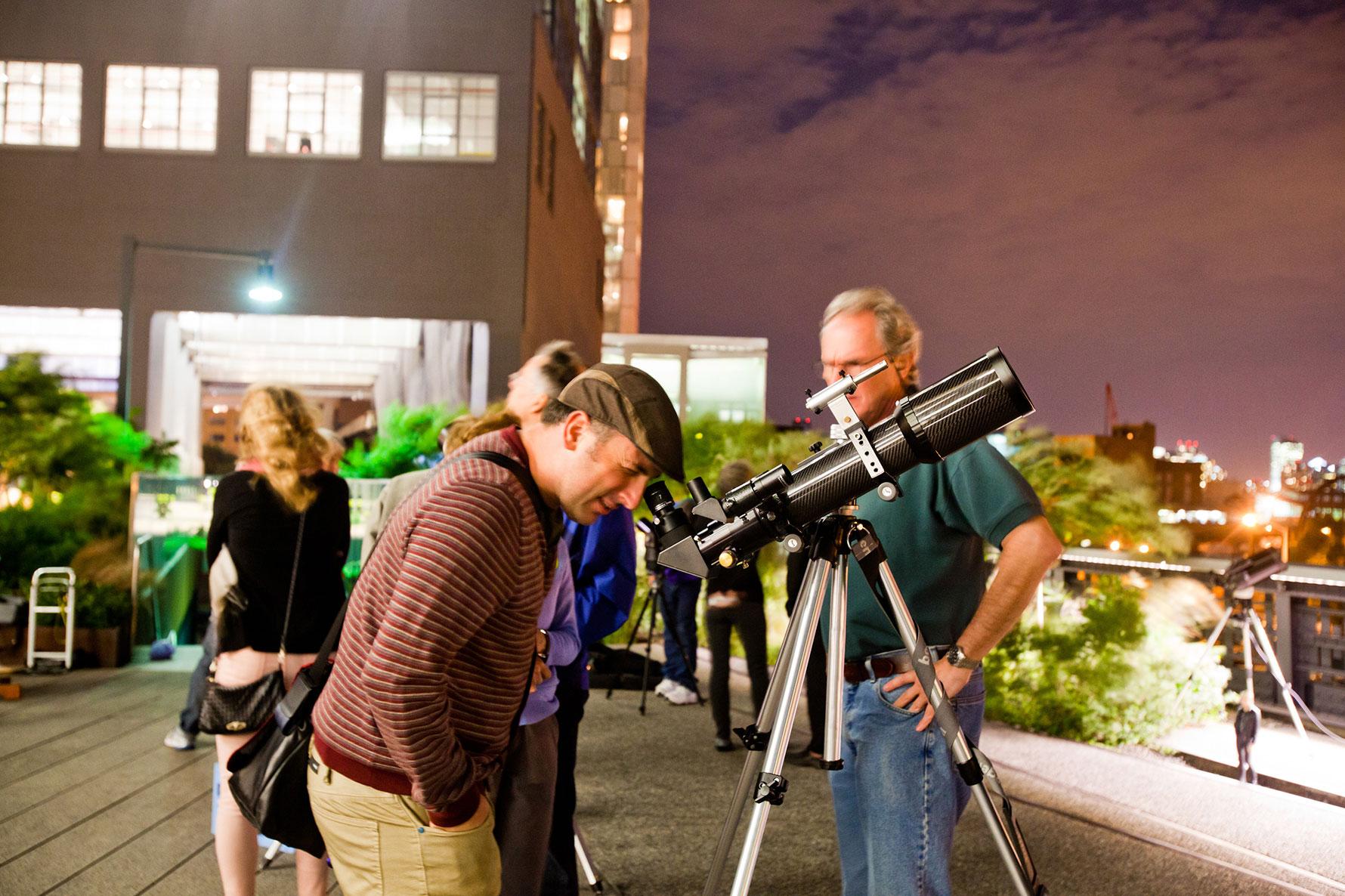 A person looking through a telescope
