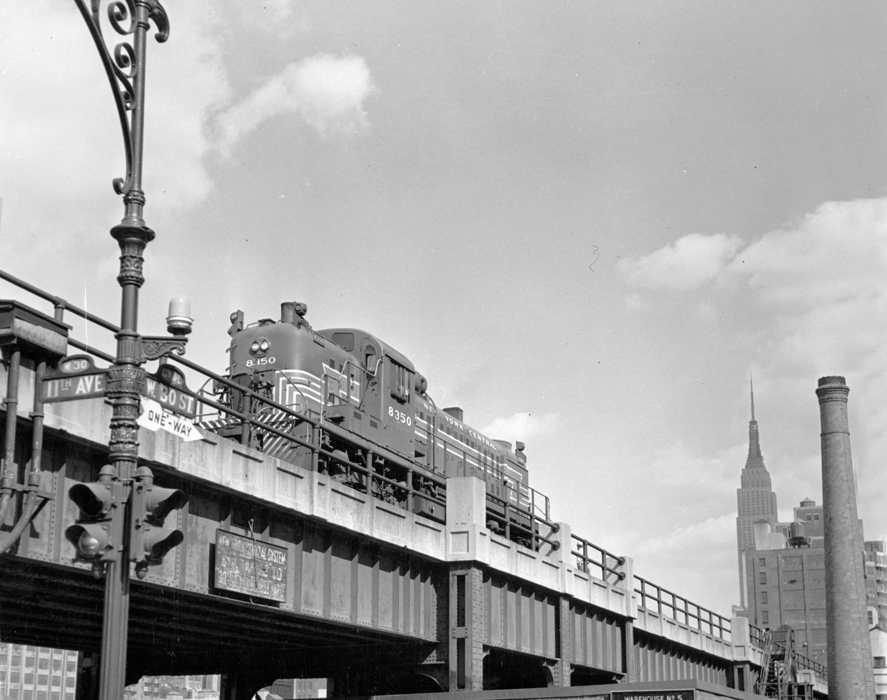 A black-and-white photo of the original elevated High Line in NYC