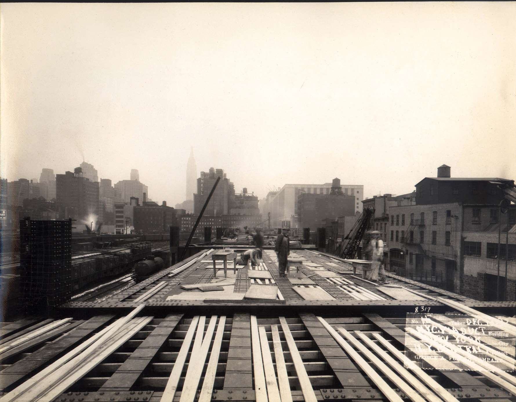 A black-and-white photo of the High Line being built in the 1930s