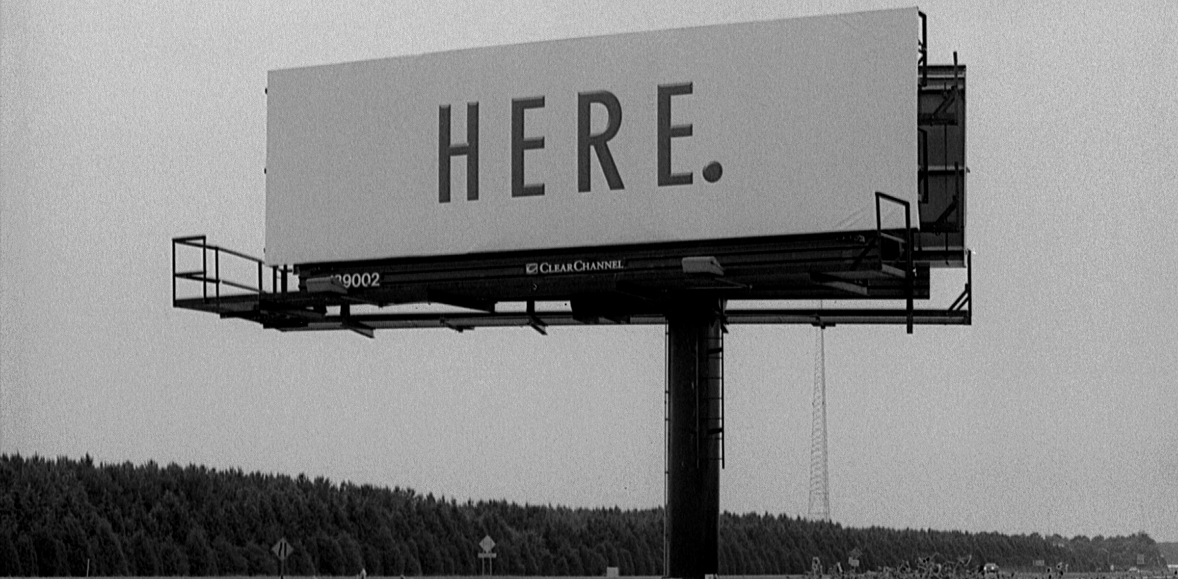 """A billboard that reads """"Here."""""""