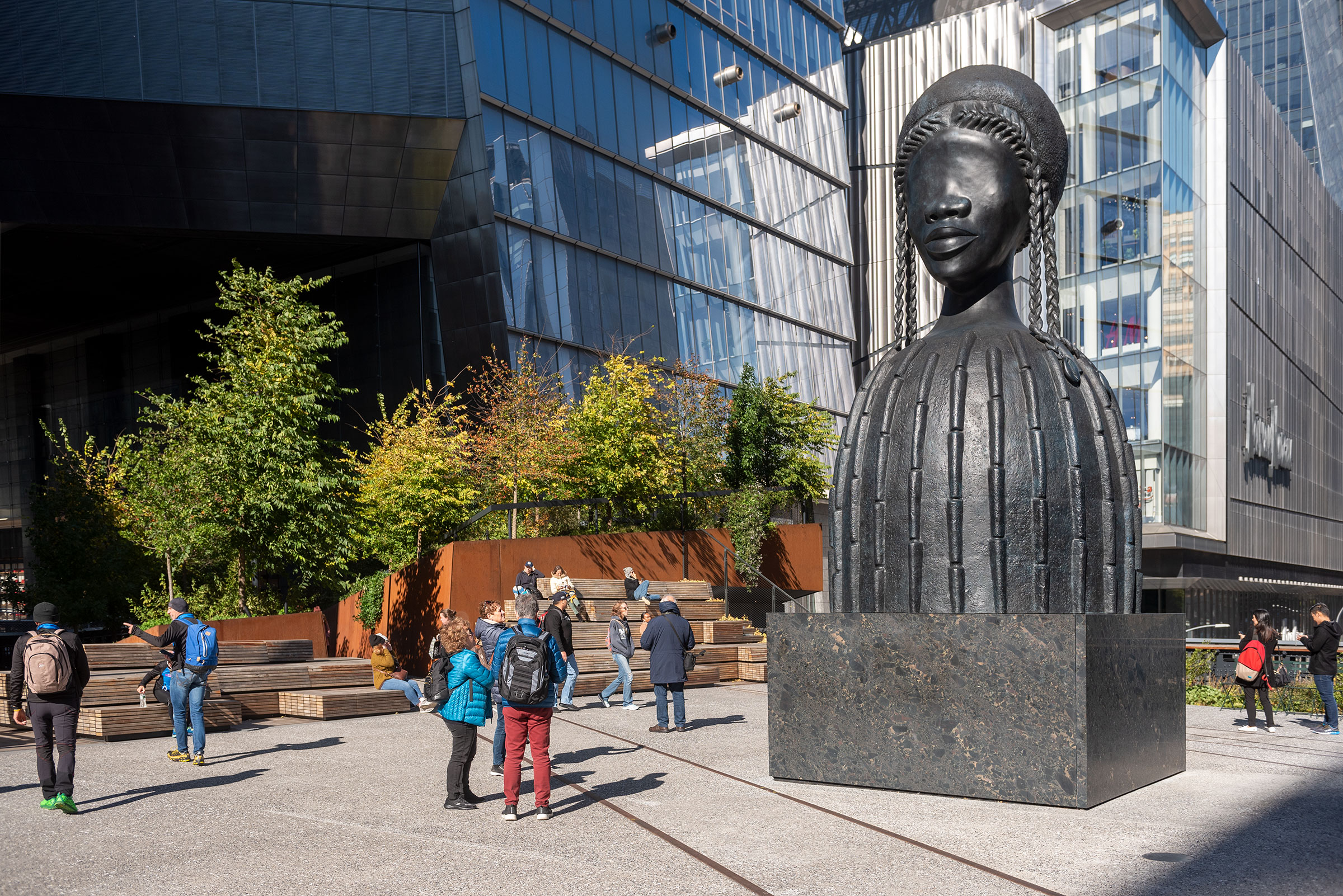 A large bronze bust of a Black woman